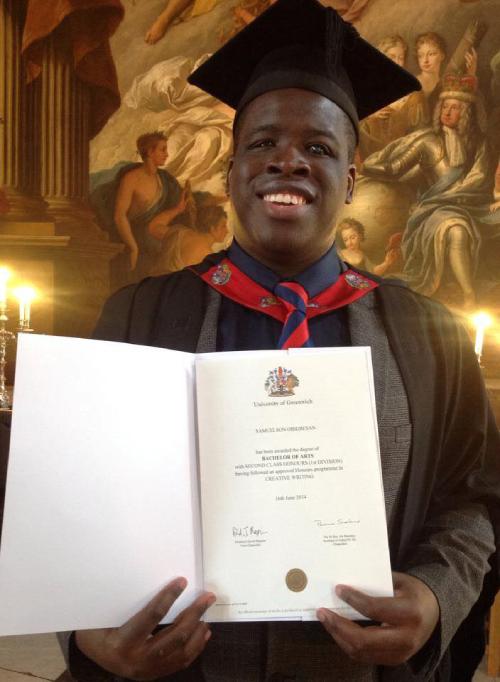 Sam graduating with a BA degree