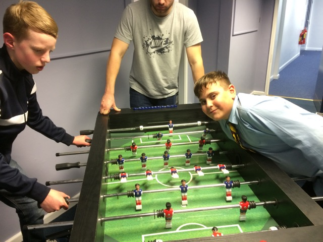 Boys having fun playing table football