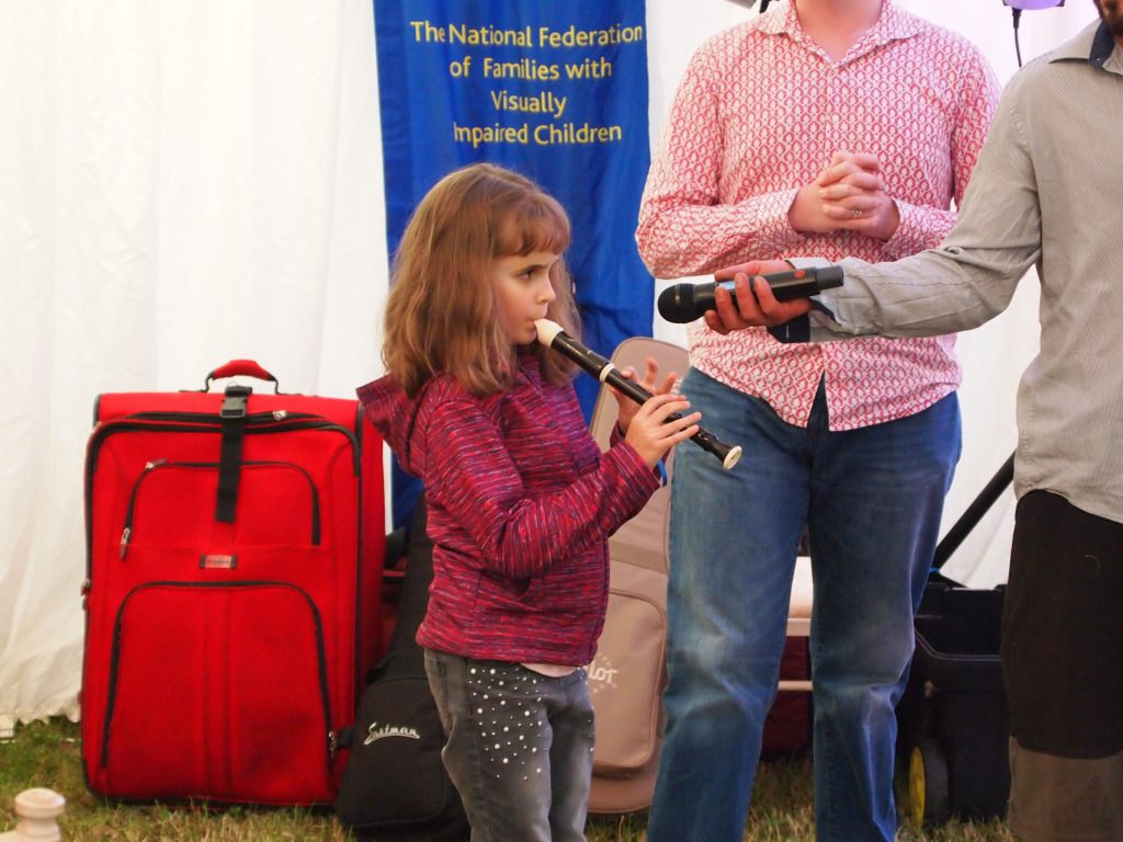 picture of young girl playing recorder.