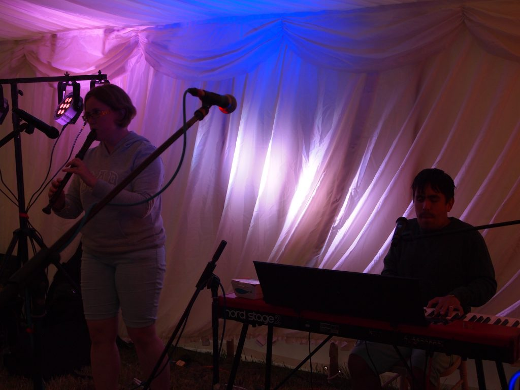 kevin and helena, playing the recorder and piano .
