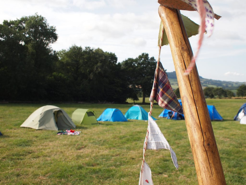 view of camping tents and bunting in the foreground