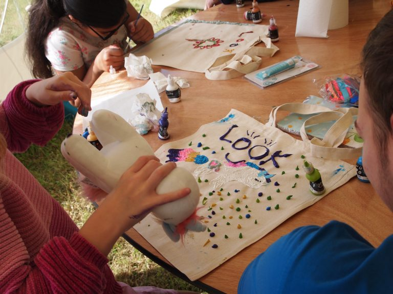 children designing their own tote bags