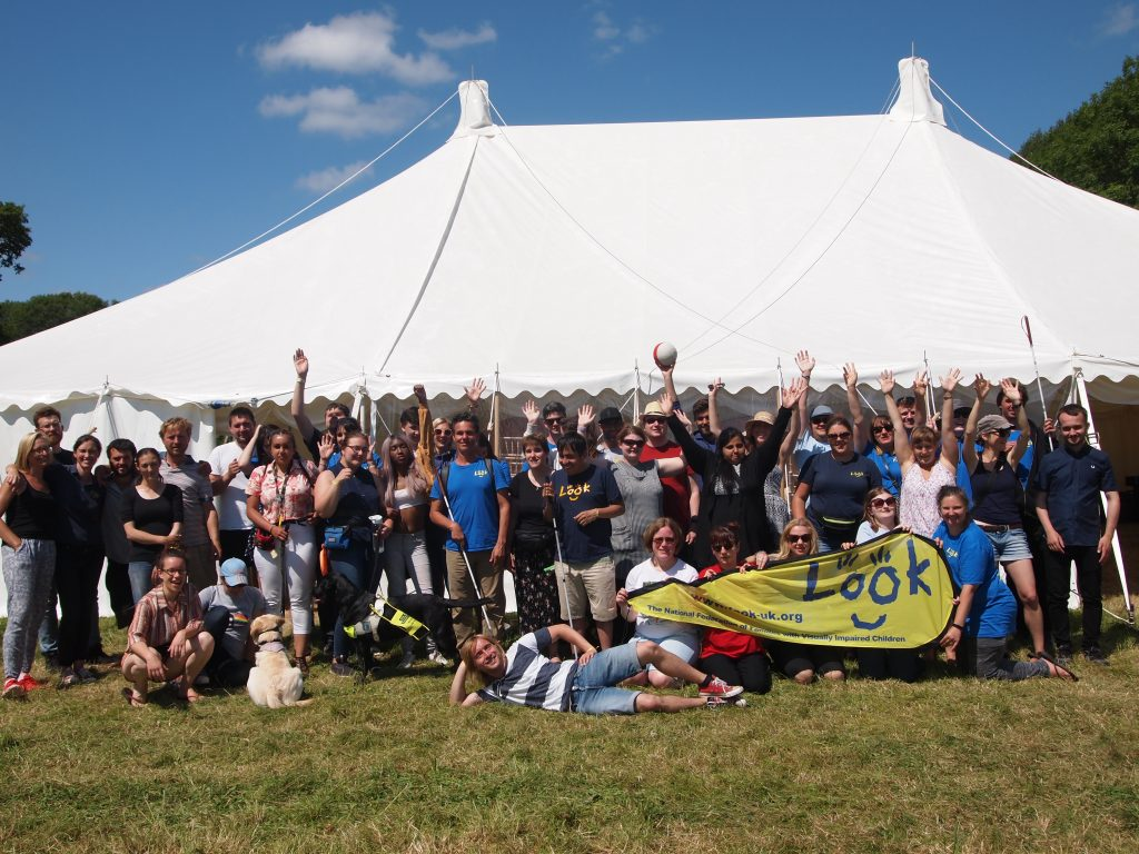 group shot of LOOK Fest staff and volunteers with arms raised.