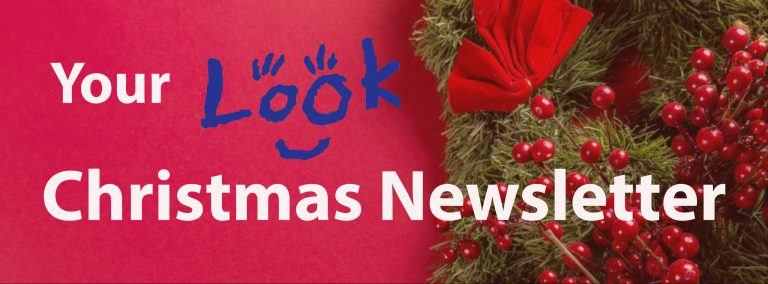 a christmas banner that reads your look christmas newsletter with a wreath in the background.
