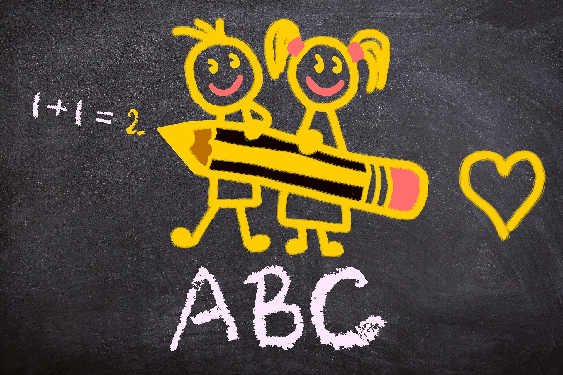 Image shows a blackboard with yellow chalk drawings of 2 children holding a pencil and writing the sum 1+1 = 2, ABC and a chalk heart.