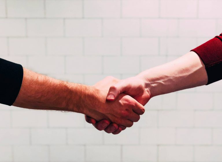 two arms shaking hands