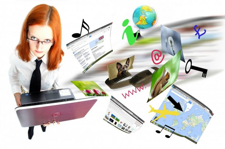 Image shows a red-headed woman wearing glasses, holding a laptop, with web pages swirling around her, a globe, images of a key, arrow, aeroplane and musical note.