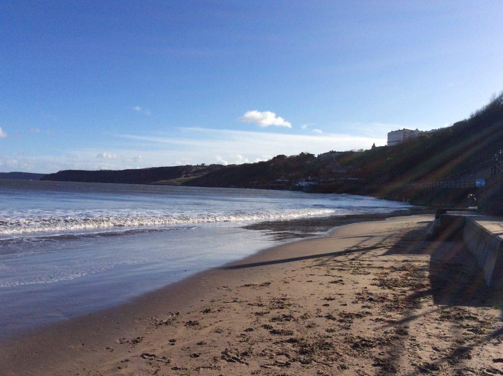 A sunny, sandy bay and beautiful blue sea.