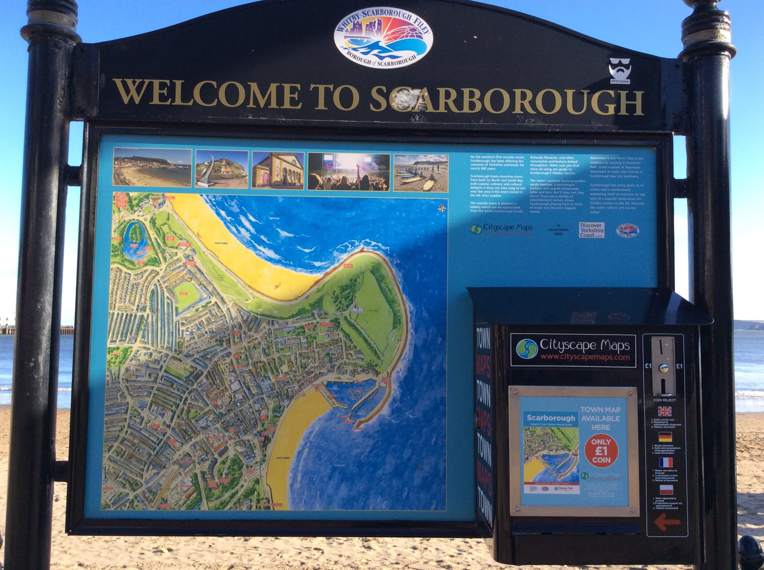 Image Description - Large Welcome to Scarborough sign, with a detailed map of the area and a map vending box attached to the side.⠀⠀