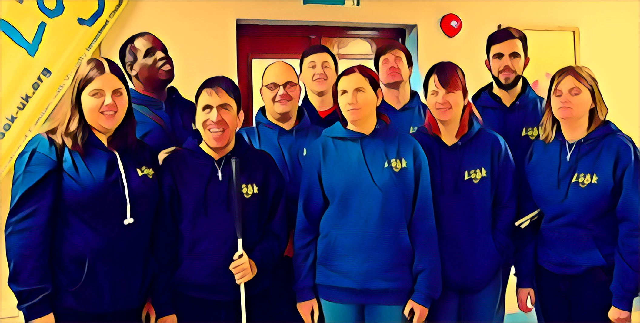 The video image shows a picture of 10 LOOK mentors. The picture, which was originally a photo, has a filter on it which makes it look like an illustration. The mentors wear blue LOOK hoodies, with the LOOK logo in yellow on the left chest. The background is yellow. White text in the lower third reads: National Braille Week: Braille in the Alphabet, a poem by Natalie.