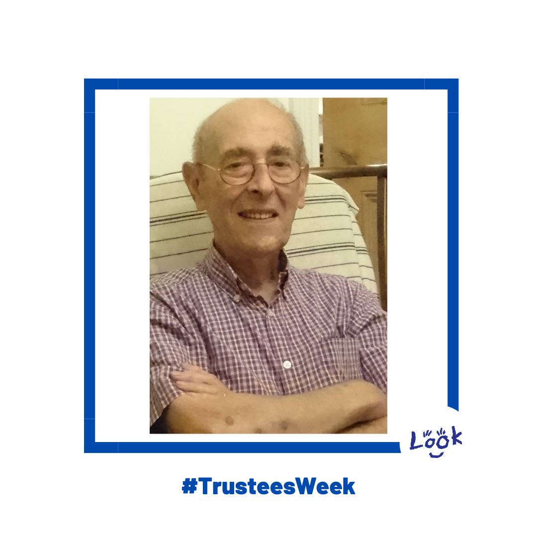 Image shows a photo of Michael, arms folded sat in a chair wearing a chequered red and white shirt, smiling. The photo is set within a blue frame on a white background with #TrusteesWeek written in blue at the bottom of the pic; the LOOK logo os in the bottom right hand corner.