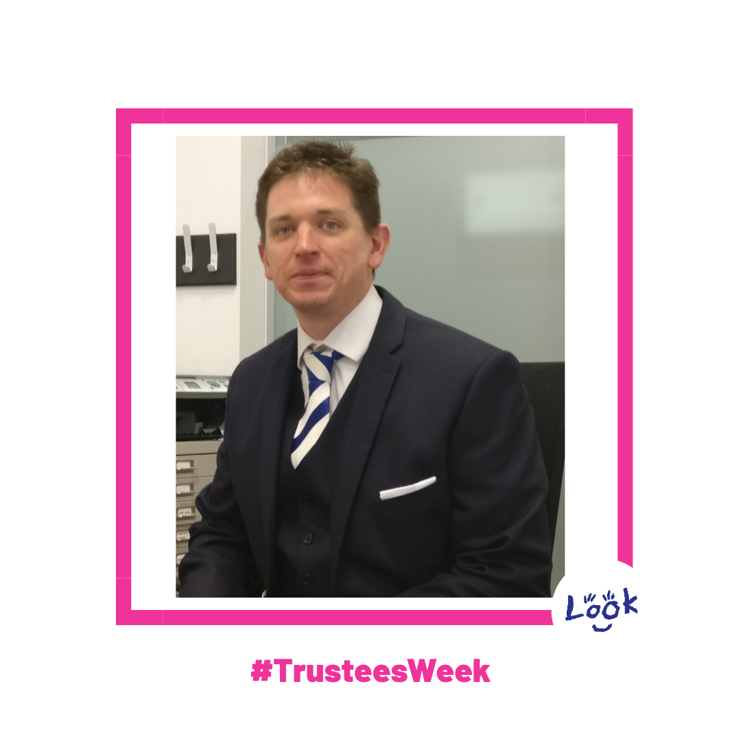 Photo of Simon Morris, wearing a navy suit and navy and white tie. Photo is mounted on a white background within a bright pink frame. #TrusteesWeek is written in pink text beneath teh photo and teh LOOK logo appears in the right hand corner.