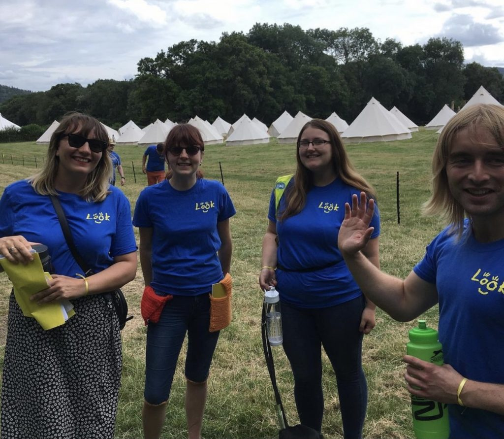4 people at LOOKFest wearing blue and yellow LOOK t-shirts.