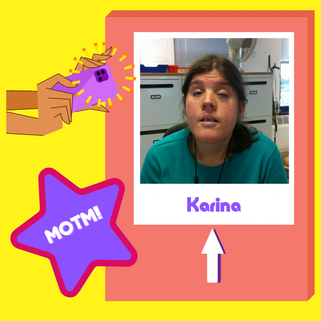 """Graphic image showing a photo of Karina wearing a green, round-neck top with white drawers in the background. Photo is set within a white frame and 'Karina' appears in purple text at the bottom. Set on a peach-coloured background, with a cartoon pair of arms with a camera pointing at Karina's photo and the LOOK blue star with 'MOTM!"""" written in white across the centre. All based on a bright yellow background."""
