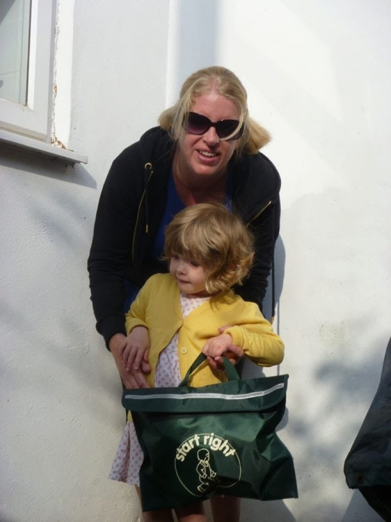 Photo of Jane Ring with daughter Chloe when she was younger, holding a Start Right book bag.