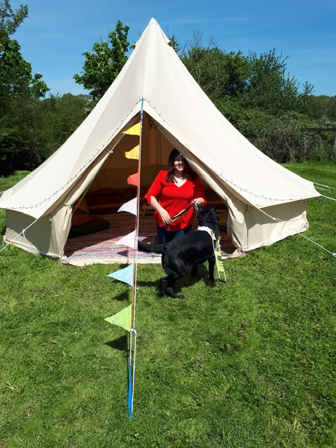 Elin and guide dog Jazzy sat inside a bell tent at LOOKFest.